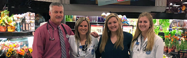 Daniel Krinsky, R.Ph. and a group of pharmacy students