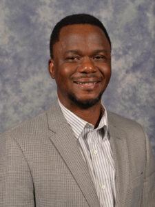 headshot of moses oyewumi