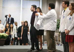 Student receiving white coat