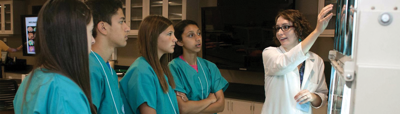 Students viewing x-rays with faculty