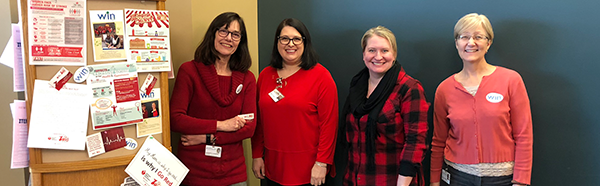 Women in NEOMED group wearing red shirts