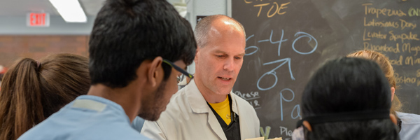 Christopher Vinyard, Ph.D, working with students
