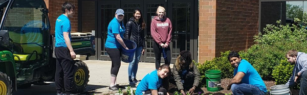 NEOMED students planting flowers