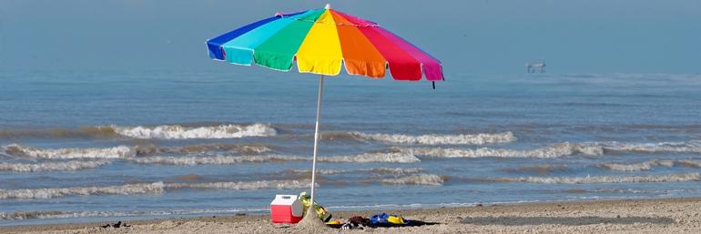 Beach and beach umbrella