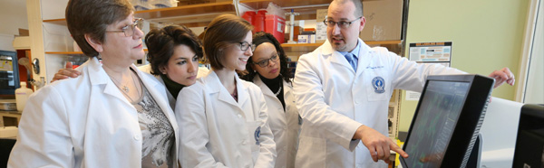 Jason Richardson, Ph.D., and others in a lab