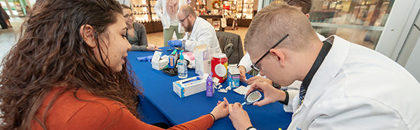 NEOMED pharmacy students conducting diabetes screenings
