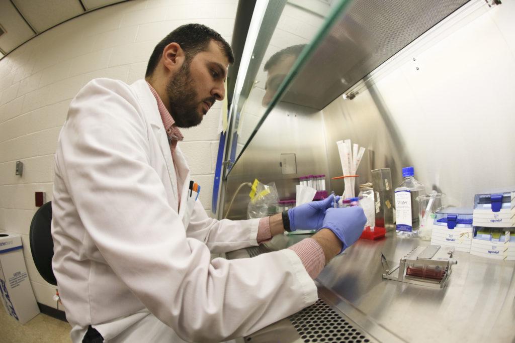Nazar Hussain working to prepare cells