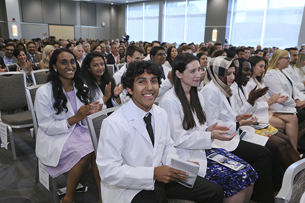 Group of first-year medicine students after putting on their white coats for the first time