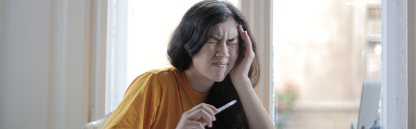 Woman suffering from headache/earache