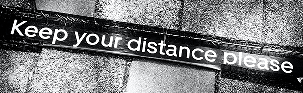 Keep you distance please taped on stone flooring