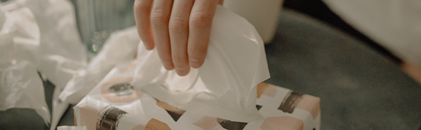 Hand reaching for tissue box