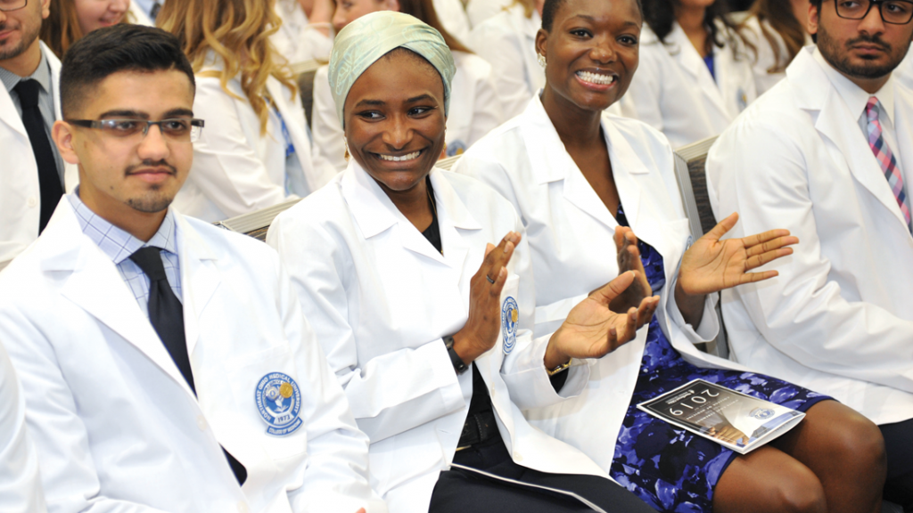 Students clapping at NEOMED white coat ceremony